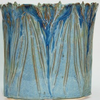 carved iris vase